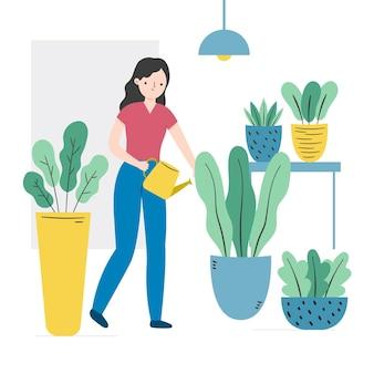 Donna che innaffia le sue piante domestiche