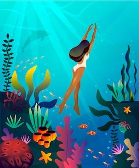 Donna che nuota sott'acqua nell'oceano. concetto per ocean day o agenzie turistiche.