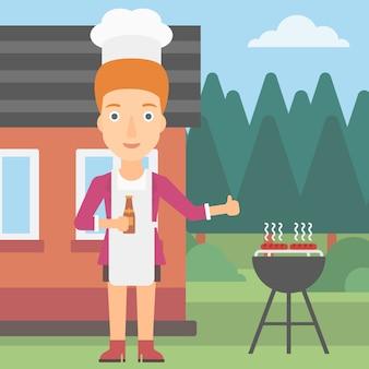 Donna che prepara il barbecue.