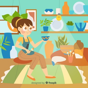 Donna che produce e dipinge ceramiche