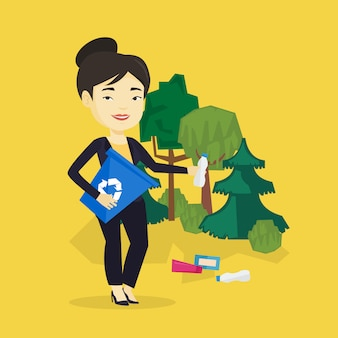Donna che raccoglie immondizia in foresta.