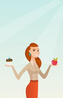 Donna che sceglie tra apple e cupcake.