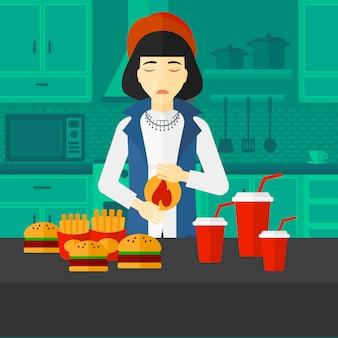 Donna che soffre di bruciore di stomaco.