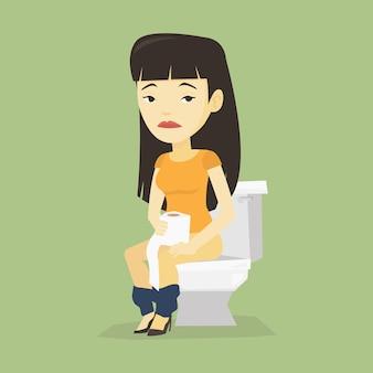 Donna che soffre di diarrea o costipazione.