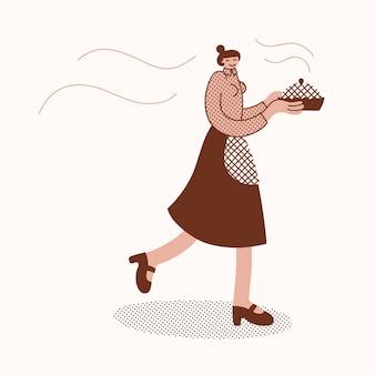 Donna classica di stile casalinga che cammina con una torta appena sfornata in mano indossando un grembiule