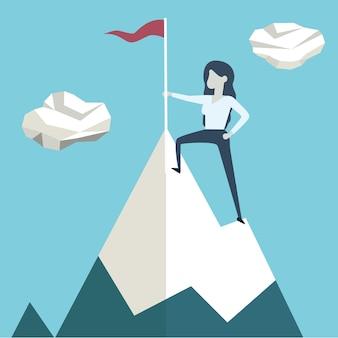 Donna con bandiera su un picco di montagna