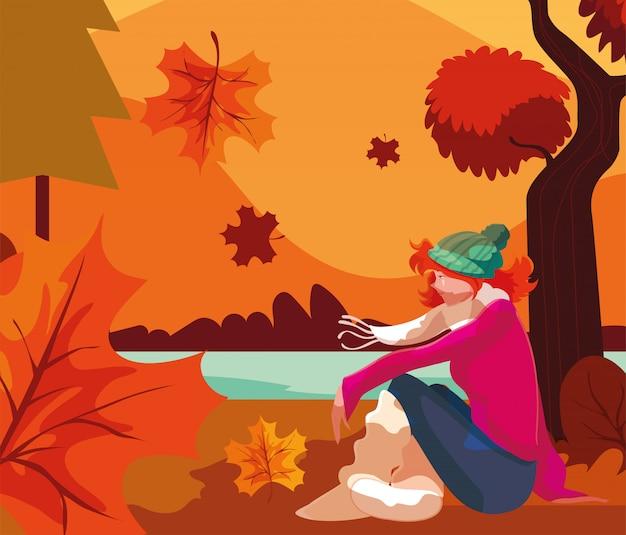 Donna con cappello nel paesaggio autunnale