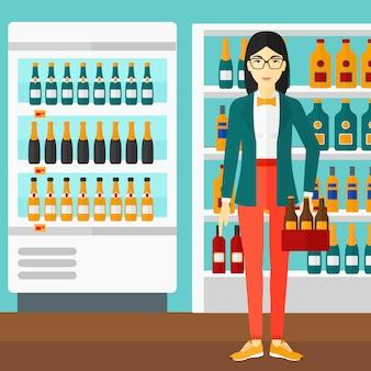Donna con confezione di birra