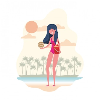 Donna con costume da bagno e secchio di sabbia
