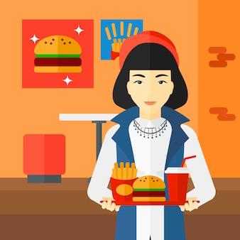 Donna con fast food.