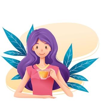 Donna con l'ora del tè alle erbe