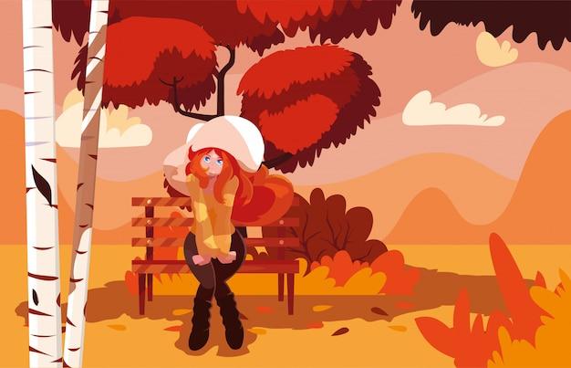 Donna con la sedia del parco nel paesaggio dell'autunno