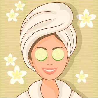 Donna con maschera facciale di cetriolo