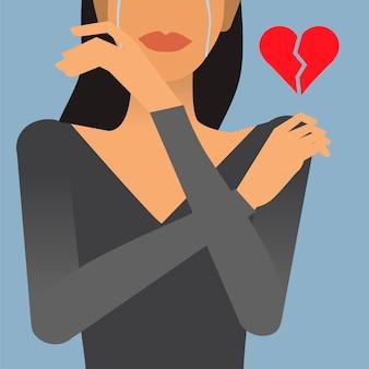 Donna con un'illustrazione di cuore spezzato