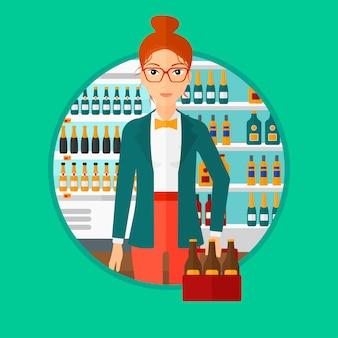 Donna con un pacchetto di birra al supermercato.
