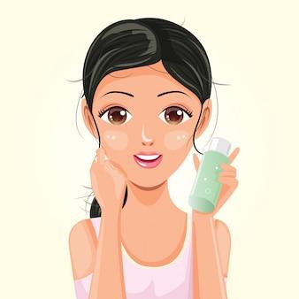 Donna con una bottiglia di essenza