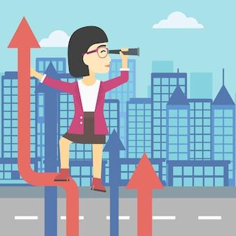 Donna d'affari con spyglass sulla freccia in aumento
