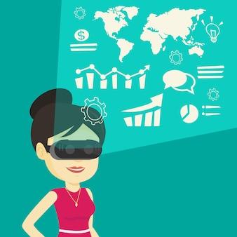 Donna di affari in cuffia avricolare del vr che analizza i dati virtuali
