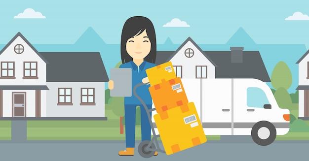 Donna di consegna con scatole di cartone.