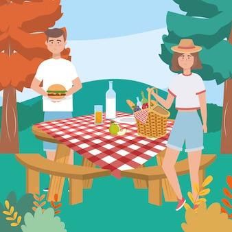 Donna e uomo con hamburger e bottiglia di latte con pane