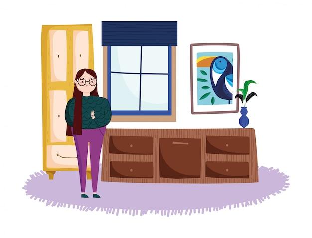 Donna in camera con cassetti per il tempo libero