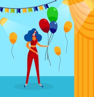 Donna in costume da clown su sfondo backstage.