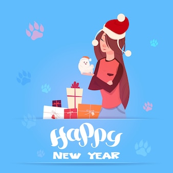 Donna in santa hat holding cute pomerian dog winter holidays 2018 banner anno nuovo greeting card design