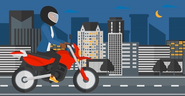 Donna in sella a moto.