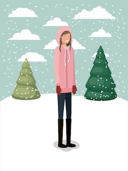 Donna in snowscape con abiti invernali