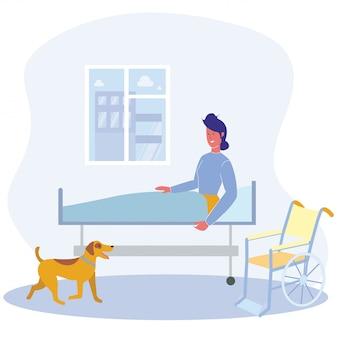 Donna nel cane di assistenza di mobilità del reparto dell'ospedale