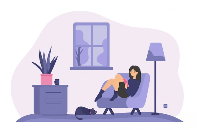 Donna rilassata che si siede in poltrona con il libro