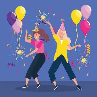Donne carine con fuochi d'artificio cappello e scintille di partito