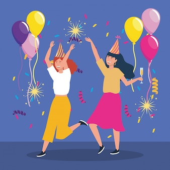 Donne carine con fuochi d'artificio scintillii e palloncini