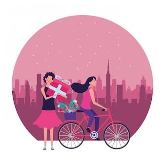 Donne con l'illustrazione rotonda del regalo e della bicicletta