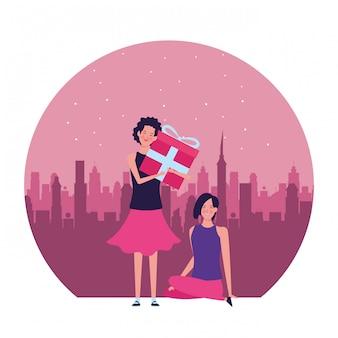 Donne con l'illustrazione rotonda del regalo