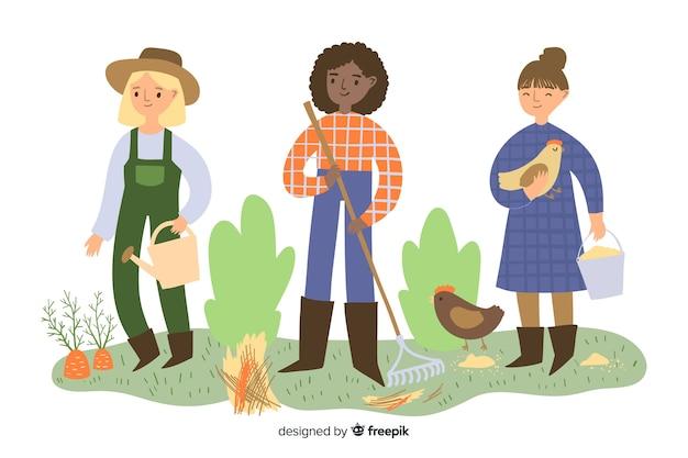 Donne contadine che svolgono insieme lavoro agricolo