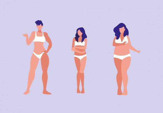 Donne di diverse dimensioni modellano biancheria intima