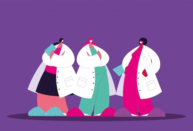 Donne dottoresse in piedi, gruppo di medici