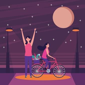 Donne in sella a bici con fiore