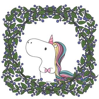 Doodle di unicorno in cornice di foglie e fiori.