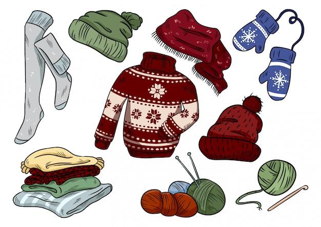 Doodles hygge accoglienti. adesivi casuali vestiti carini. plaid, filati, maglieria, cappello, maglione, calze