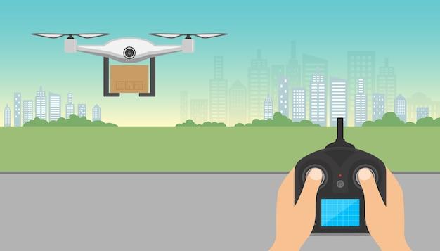 Drone che trasporta la scatola di cartone con telecomando che sorvola la città