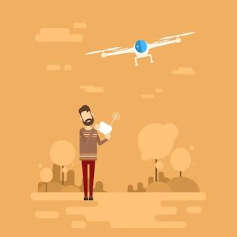 Drone del telecomando della tenuta dei pantaloni a vita bassa dell'uomo