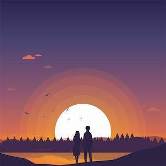 Due amanti amanti felici guardando il tramonto