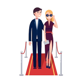 Due celebrità ricche a piedi su un tappeto rosso