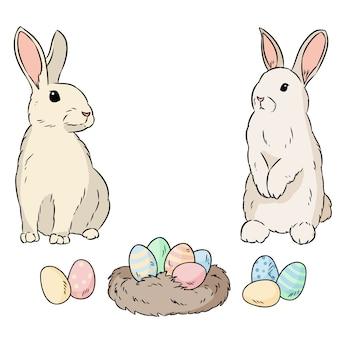 Due conigli di pasqua e uova di pasqua