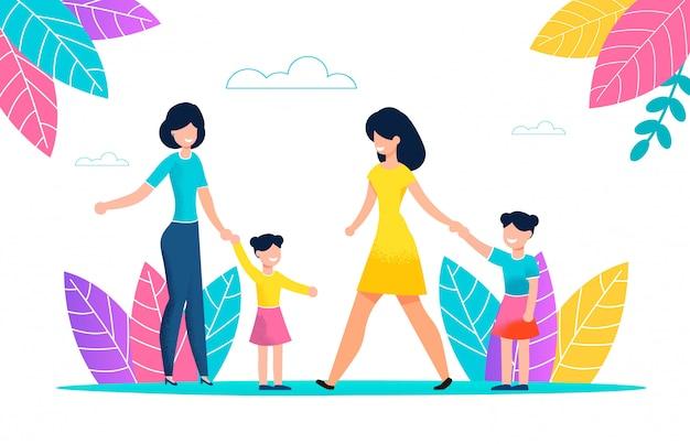 Due giovani donne a piedi con i bambini nel parco