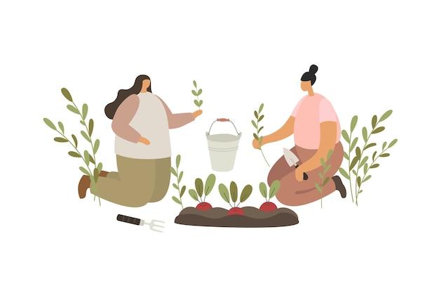 Due ragazze che piantano piantine sui letti. persone che lavorano in giardino.