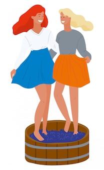 Due ragazze che schiacciano l'uva con l'immagine dei piedi