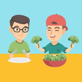 Due ragazzi caucasici che mangiano i broccoli.